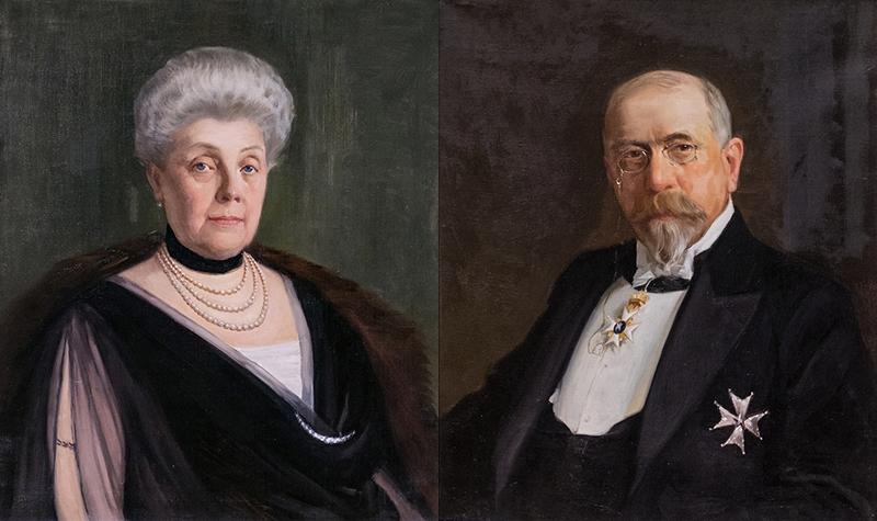 målning av en Antonie Rettig i pärlhalsband och John Rettig i glasögon och medalj på bröstet.