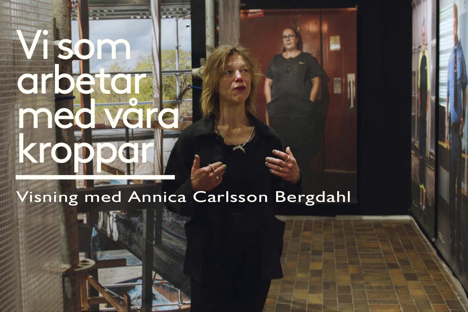 Annica Carlsson Bergdahl framför utställningen.